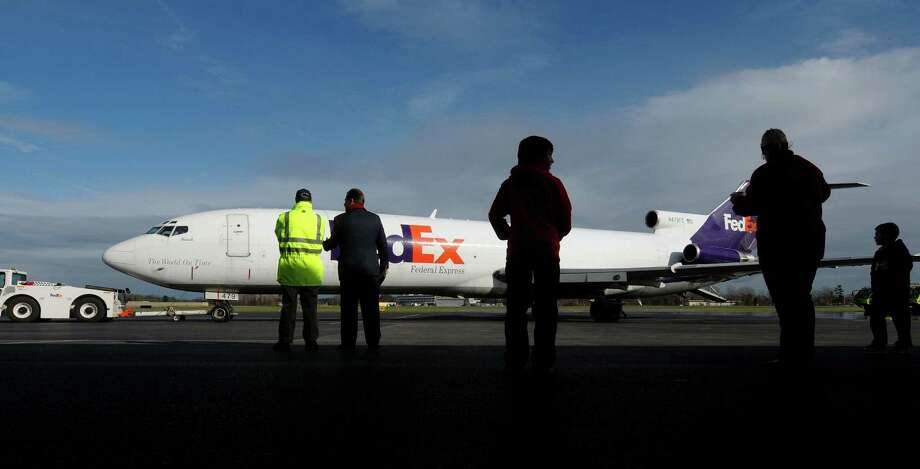 A FedEx cargo plane arrives at the Albany International Airport on Thursday, Nov. 8, 2012 in Colonie, NY.  The plane manufactured in 1978 for Braniff Airways and FedEx took delivery of the plane from Braniff in 1990 and had been using the plane to deliver packages up until last month.  FedEx donated the Boeing 727-200F aircraft to the Airport Authority which will use the plane for training the Albany International Airport Rescue Fire Fighting Unit.    (Paul Buckowski / Times Union) Photo: Paul Buckowski  / 00020027A