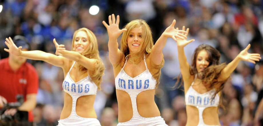 With their new uniforms, the Dallas Mavericks dancers are taking skimpy to a whole new level. Photo: Matt Strasen, Associated Press / FR170476 AP