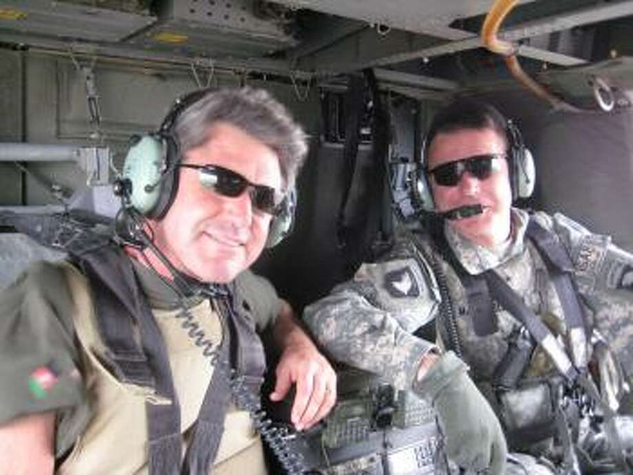 Congressman McCaul in a blackhawk helicopter.