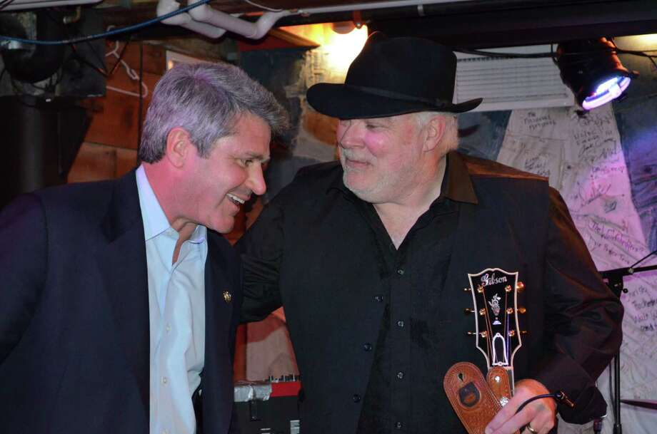 . Michael McCaul chats with Dallas Wayne at the Hill RepCountry BBQ benefit for Bastrop County wildfire victim.  Wayne, a country music singer, songwriter and host on SiriusXM Radio, lost his home in the Bastrop fires. (Congressional photo)