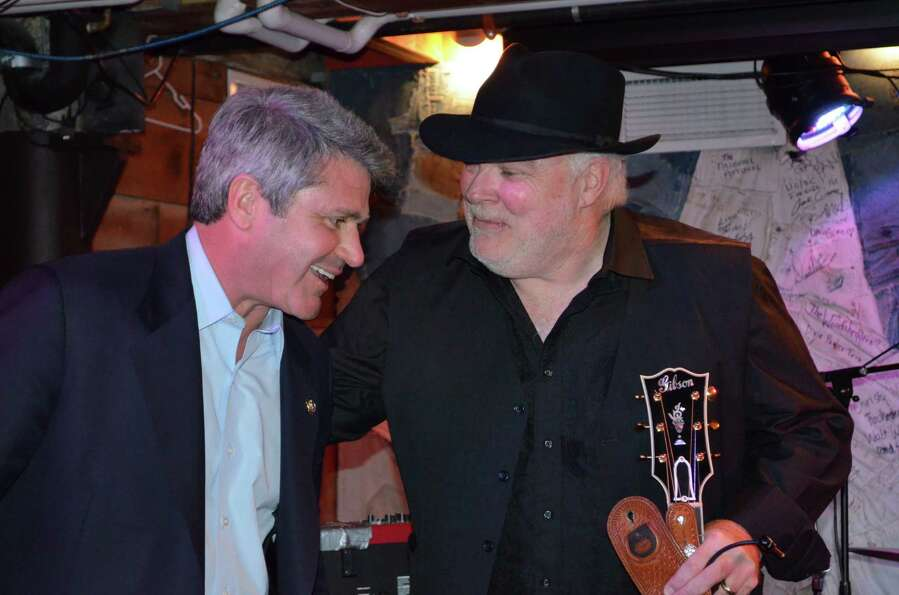 . Michael McCaul chats with Dallas Wayne at the Hill RepCountry BBQ benefit for Bastrop County wildf