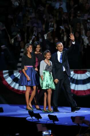 President Barack Obama, first lady Michelle Obama and their daughters, Malia, left, and Sasha take the stage at President Obama's election event at McCormick Place Lakeside Center in Chicago, following Election Day, early Wednesday morning, Nov. 7, 2012. President Obama has been elected to a second term. Photo: DAMON WINTER, New York Times / NYTNS
