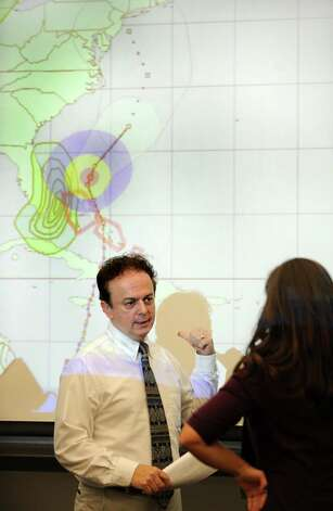 Bill Jacquemin, Meteorologist Connecticut Weather Center, discusses storm preparedness for hurricane Sandy in a meeting at the Emergency Operations Center, 581 North Washington Ave., in Bridgeport, Conn. on Thursday, Oct. 25, 2012. Photo: Cathy Zuraw / Connecticut Post