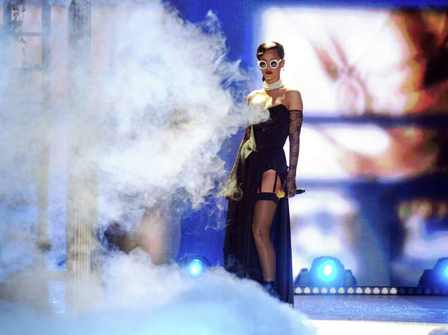 Singer Rihanna performs during the 2012 Victoria's Secret Fashion Show on Wednesday Nov. 7, 2012 in New York. The show will be broadcast on Tuesday, Dec. 4 (10:00 PM, ET/PT) on CBS. (Photo by Evan Agostini/Invision/AP) Photo: Evan Agostini, INVL / Invision