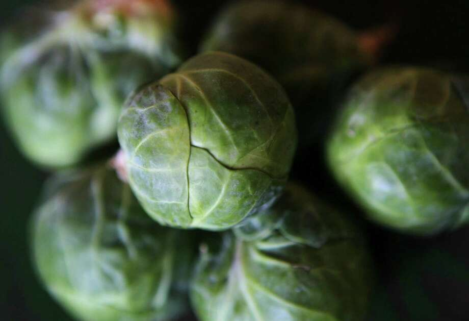 Studies have shown that the compound alpha-lipoic acid, which is found in brussels sprouts and other red and green produce, helps lower triglyceride levels by as much as 60 percent. Photo: Emily M Rasinski, MBR / ARCHIVE