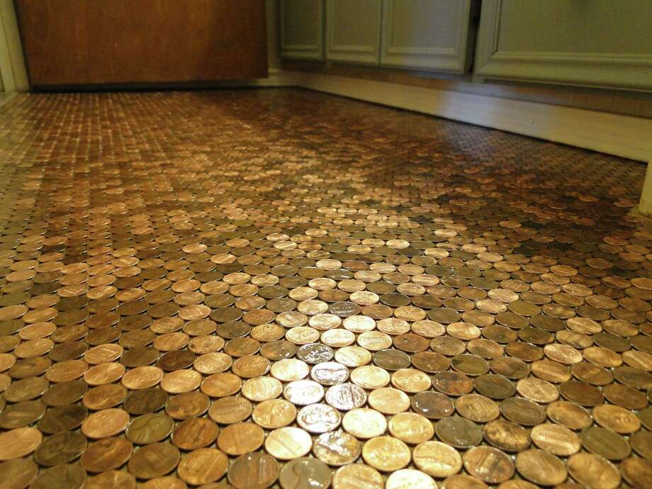 New Braunfels homeowner Doreen Fisher used almost 10,000 pennies to a bathroom floor. She kept the random pattern and the variations in color to give the floor a patina. Photo: Tracy Hobson Lehmann
