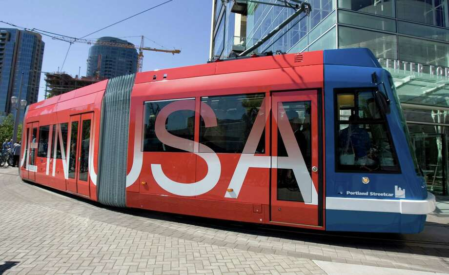 An American-made prototype streetcar begins its' first trip on the rails in Portland, Ore., Wednesday, July 1, 2009. The streetcar, manufactured by Oregon Iron Works, is the first streetcar made in the USA in 58 years.(AP Photo/Don Ryan) Photo: Don Ryan, ASSOCIATED PRESS / AP2009