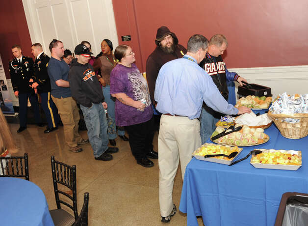 People line up for food during a luncheon at Schenectady County Community College to honor veterans after a colors ceremony Friday, Nov. 9, 2012 in Schenectady, N.Y. (Lori Van Buren / Times Union) Photo: Lori Van Buren