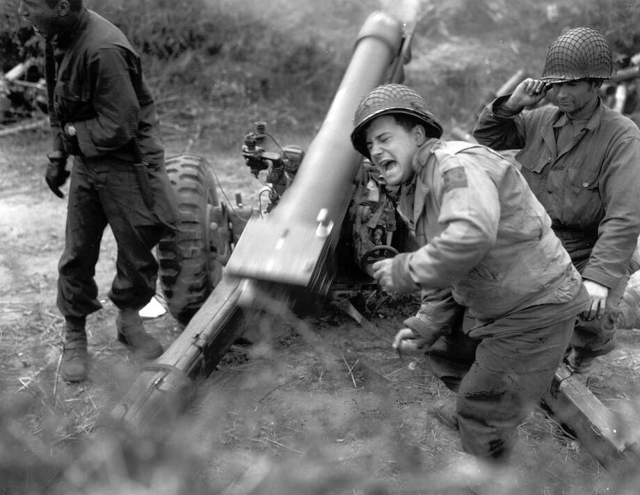 A U.S. artillery unit shells German positions during World War II. Photo: AP