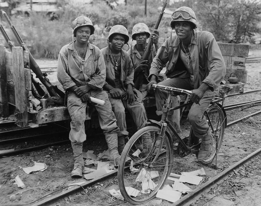 Four U.S. Marines are seen as they take a time out from supplying ammunition to the frontlines, during the invasion of Saipan, in the Mariana Islands, on August 31, 1944. Photo: ASSOCIATED PRESS / AP1944
