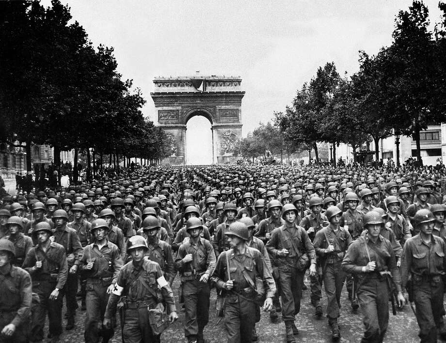 U.S. troops march in Paris after liberating France. Photo: AP