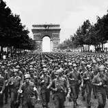 US troops march in Paris after liberating France.