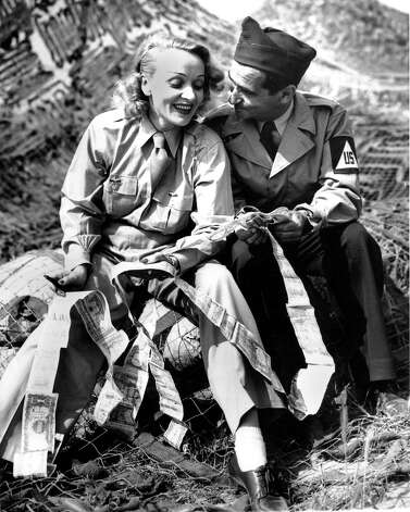 "Marlene Dietrich and Irving Berlin compare ""short snorter"" bills at a Fifth Army mobile radio station in Spigno, Italy on May 27, 1944  during World War II. Photo: ASSOCIATED PRESS / AP1944"