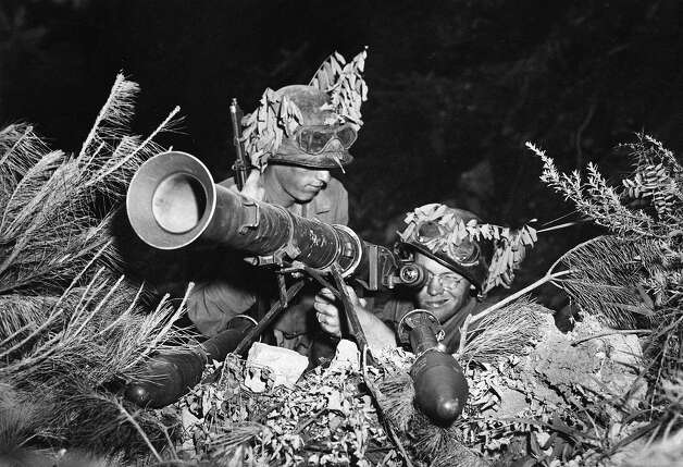 Two American soldiers line up a 3.5 rocket launcher bazooka along the battlefront somewhere in Korea, July 24, 1950. Photo: ASSOCIATED PRESS / AP1950