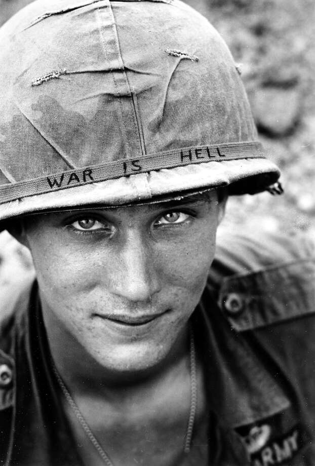 "An unidentified U.S. Army personnel wears a hand lettered ""War Is Hell"" slogan on his helmet, June 18, 1965, during the Vietnam War. He was with the 173rd Airborne Brigade Battalion on defense duty at Phouc Vinh airstrip in South Vietnam. Photo: HORST FAAS, AP / 1965 AP"
