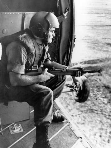 SP5 Leon B. Talley, of Tacoma, Wash. keeps his carbine ready as his U.S. Army helicopter approach the rendezvous area of Ap My Qui, South Viet Nam for cleanup operation a against Communist  led Viet Cong forces in that Mekong River delta battle zone on April 29, 1962. The U.S. helicopter carried South Viet Nam soldiers for the task of flushing  out the Viet Cong. Photo: Joe Caneva, AP / 1962 AP