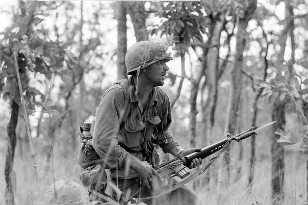 "2nd Lt. R. C. ""Rick"" Rescorla moves carefully with fixed bayonet through the underbrush in an attack of North Vietnamese sniper pockets outside the American perimeter in the Ia Drang Valley on Nov. 16, 1965 during the Vietnam War.  The soldier is a member of one of the hardest hit companies of the 1st Cavalry Division units. Photo: PETER ARNETT, AP / 1965 AP"