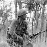 "2nd Lt. R. C. ""Rick"" Rescorla moves carefully with fixed bayonet through the underbrush in an attack of North Vietnamese sniper pockets outside the American perimeter in the Ia Drang Valley on Nov. 16, 1965 during the Vietnam War.  The soldier is a member of one of the hardest hit companies of the 1st Cavalry Division units.Rescorla, was born in Britain and served in the military there and on the Metropolitan police force before moving to New York and joining the U.S. Army. He was killed in the South Tower of the World Trade Center on September 11, 2001."