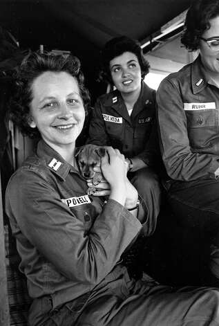 Three U.S. Army nurses serving at a field hospital at Nha Trang, north of the U.S. naval base at Cam Ranh Bay, are seen on July 15, 1965. One of them holds the little dog that Capt. Gladys E. Sepulveda, rear center, found at the beach two days ago after coming ashore from her transport ship. Photo: ASSOCIATED PRESS / AP1965