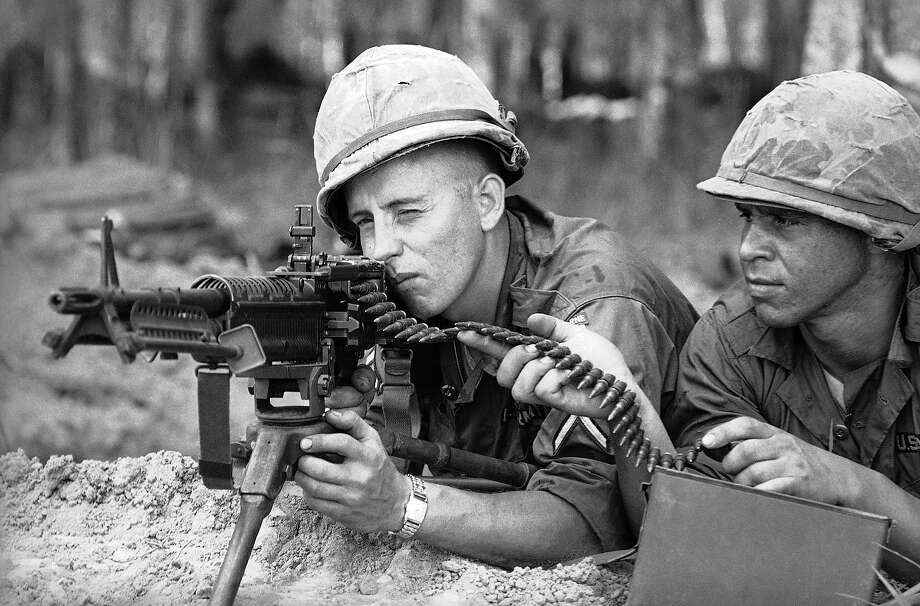 Paratroopers of the U.S. 173rd Airborne Brigade man a machine gun position after they advance into a rubber plantation near Bien Hoa air base, 12 miles northeast of Saigon in Vietnam on May 10, 1965. The plantation area had been frequency used by Viet Congs for ambush. Photo: HCL, AP / AP1965