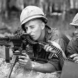 Paratroopers of the U.S. 173rd Airborne Brigade man a machine gun position after they advance into a rubber plantation near Bien Hoa air base, 12 miles northeast of Saigon in Vietnam on May 10, 1965. The plantation area had been frequency used by Viet Congs for ambush.