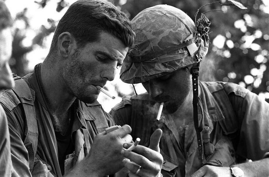 Commanders of two U.S. Marine companies who had been surrounded for two days by the North Vietnamese 324 Division eight miles south of the demilitarized zone, pause for a cigarette after other American units came to their aid, Sept. 20, 1966. They are 1st Lt. Daniel McMahon , left, of Oceanside, N.Y., who leads Delta Co., and Capt. Ronald Frederickson, South Sioux City, Neb, commander of Bravo Co. Sept. 20, 1966. Photo: ASSOCIATED PRESS / AP1966