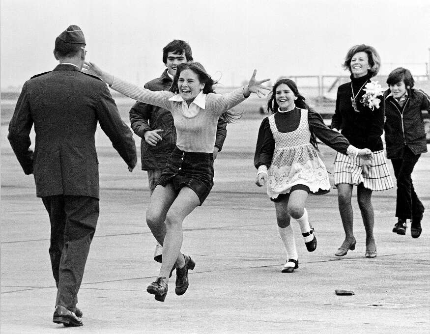 Released prisoner of war Lt. Col. Robert L. Stirm is greeted by his family at Travis Air Force Base in Fairfield, Calif., as he returns home from the Vietnam War, March 17, 1973.  In the lead is Stirm's daughter Lori, 15; followed by son Robert, 14; daughter Cynthia, 11; wife Loretta and son Roger, 12. Photo: SAL VEDER, AP / 1973 AP
