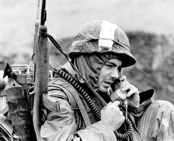 Bundled against the chill a U.S. Marine reports to his headquarters on a radiotelephone during operation Kentucky near the demilitarized zone in South Vietnam on Dec. 11, 1967. Monsoon rains and temperatures that drop into the 40s and 50s at night make life miserable for the U.S. soldiers  in the Northern provinces. Photo: Dag  VAn Phuoc, AP / AP1967
