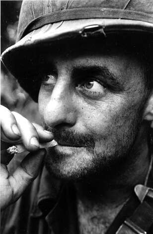 U.S. Sgt. Adolph J. Breecher of Saginaw, Michigan, fighting in the Vietnam War in 1966, is shown smoking a cigarette. Photo: HENRI HUET, ASSOCIATED PRESS / AP1966