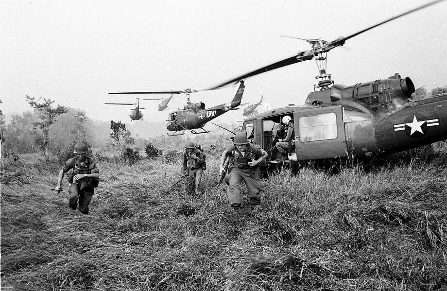 American soldiers are dropped off by U.S.Army helicopters to join South Vietnamese ground troops to advance in an attack on a Viet Cong camp 18 miles north of Tay Ninh, northwest of Saigon near the Cambodian border, in March 1965 during the Vietnam War. Photo: HORST FAAS, AP / 1965 AP