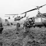 American soldiers are dropped off by U.S.Army helicopters to join South Vietnamese ground troops to advance in an attack on a Viet Cong camp 18 miles north of Tay Ninh, northwest of Saigon near the Cambodian border, in March 1965 during the Vietnam War.