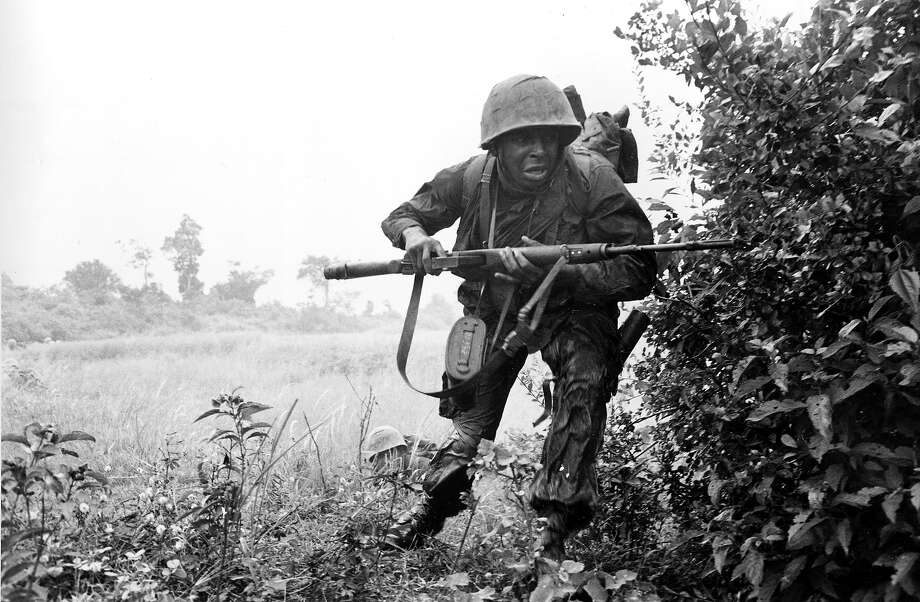 An infantryman of the U.S. 25th Division rushes for cover as he comes under sniper fire near the village of Rach Kien, 20 miles southwest of Saigon in Vietnam's Mekong Delta, in 1967 during the Vietnam War. Photo: ASSOCIATED PRESS / AP1967