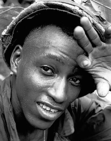 Pfc. Eugene Cabbagestalk of Pittsburgh, Pa., pushes back his helmet to wipe the sweat from his face in South Vietnam, August 1966. Cabbagestalk was killed in Vietnam the following January. Photo: Henri Huet, AP / AP1966