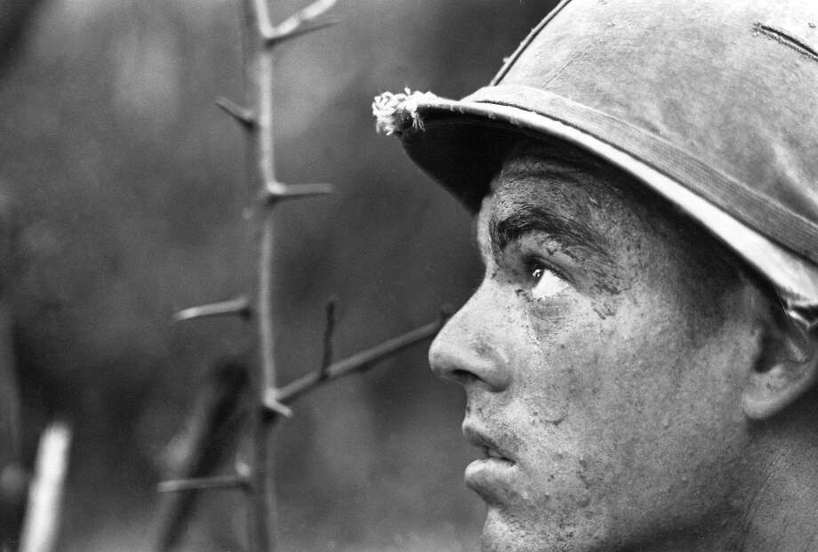 A soldier of the 25th Infantry Division, coated with sweat and grime, patrols thick jungle near the Cambodian border, Nov. 26, 1966. B-52 air strikes had driven out enemy snipers that stalled the unit for three days. Photo: Horst Faas, AP / AP1966