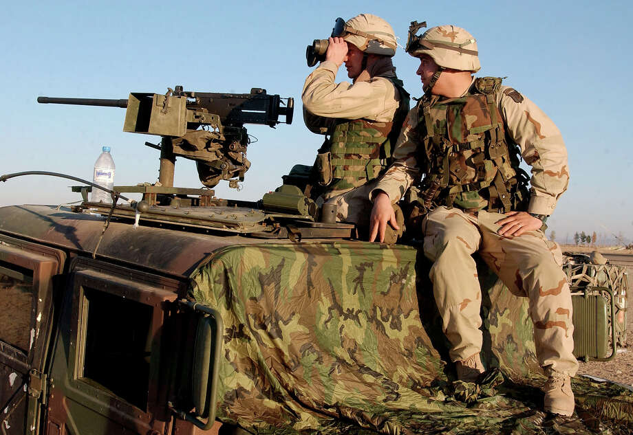 "Members of the U.S. Army 3rd Brigade 101st Airborne Division (Air Assault) ""The Rakkasans"", scan the northwest perimeter of the American compound at Kandahar International Airport on Friday Jan. 18, 2002.  U.S. soldiers replaced Marines in key defense posts at the base Friday. Photo: MARCO DI LAURO, ASSOCIATED PRESS / AP2002"