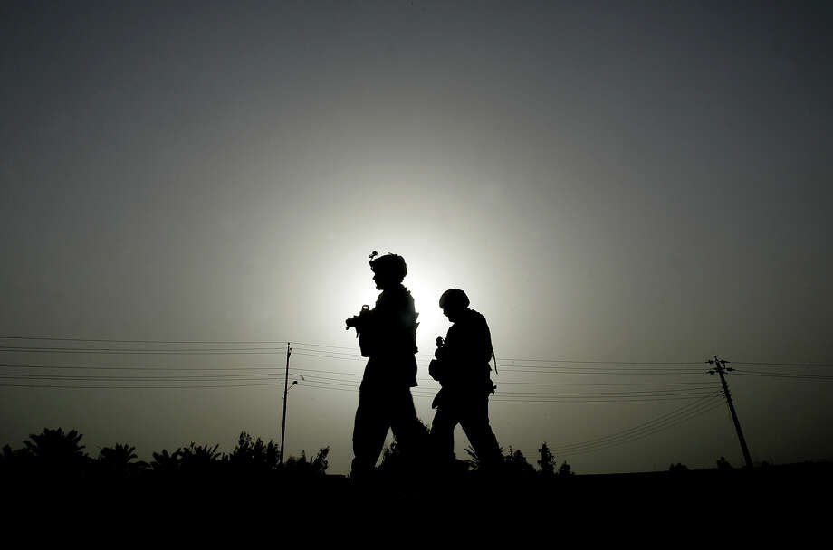 Two US soldiers of Charlie  Company, 1st Platoon, 1-15 Infantry, 3rd Brigade Combat team, 3rd Infantry Division, patrol at Salman Pak city about 30 miles (45 kilometers), south of Baghdad, Iraq, on Monday, March 3, 2008. Photo: PETROS GIANNAKOURIS, ASSOCIATED PRESS / AP2008