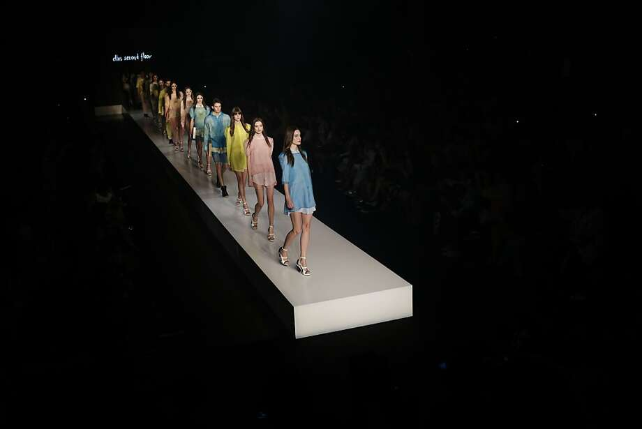 Bridge to nowhere:Models wearing creations for the 2nd Floor winter collection parade down a catwalk seemingly suspended over a black chasm at Fashion Rio. Photo: Felipe Dana, Associated Press