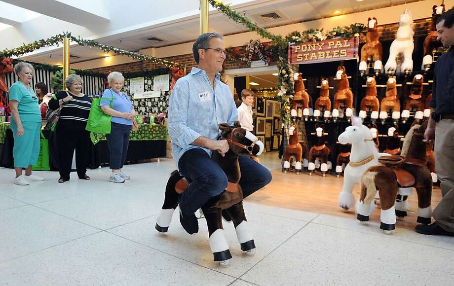 Really! A grown man! Well, I've never ...Nick Kanger gallops down the hall outside his Pony Pet Stable booth at the Mistletoe & Magic extravaganza in Tyler, Texas. Photo: Sarah A Miller, Associated Press