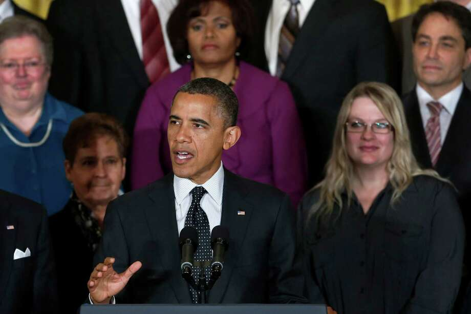 President Barack Obama gestures as he speaks about the economy and the deficit, Friday, Nov. 9, 2012, in the East Room of the White House in Washington. (AP Photo/Carolyn Kaster) Photo: Carolyn Kaster