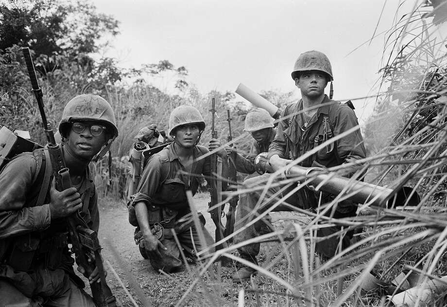U.S. Marines of the 7th Fleet's special landing team, the 1st Battalion, 26th Marines, crouch on a dirt trail with a 3.5 inch rocket launcher about one mile (2000 meters) south of the demilitarized zone (DMZ) as they respond to sniper fire during Operation Prairie against the North Vietnamese 324B Division, September 1966. Photo: AP