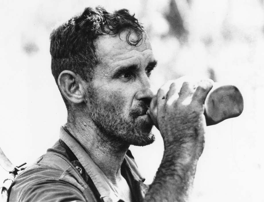 U.S. Staff Sgt. Vernon Larson of Downing, Wisc., shows a beard after nine days in the jungle without a razor, December 1965.  His unit had expected to be in the field only two days, and he was traveling light; water had to be dropped into the steamy jungle, about 40 miles north of Saigon. Photo: AP