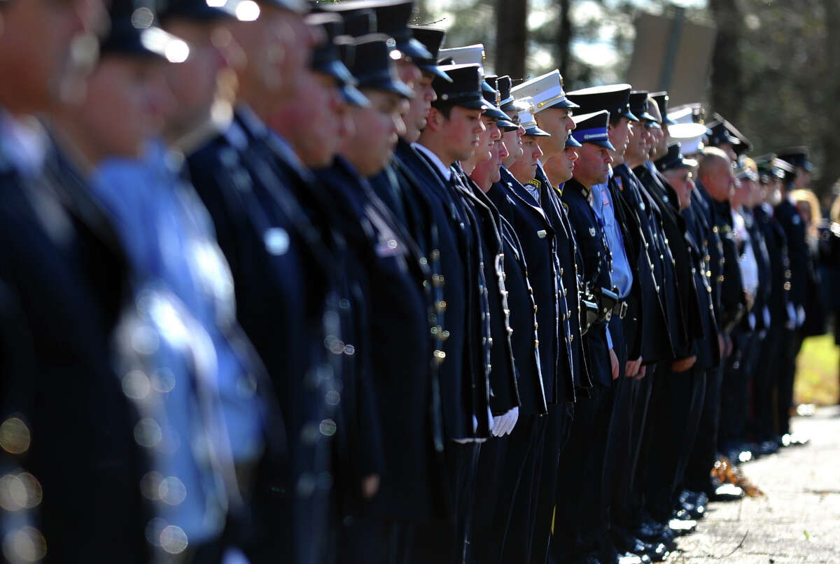 Dozens of firefighters line Morehouse Road to pay their respects at the funeral and memorial mass of Easton firefighter Russell Neary in front of Notre Dame Roman Catholic Church in Easton, Conn. on Saturday November 3, 2012. Neary died when a tree fell on him as he was on duty during Hurricane Sandy this past Monday.