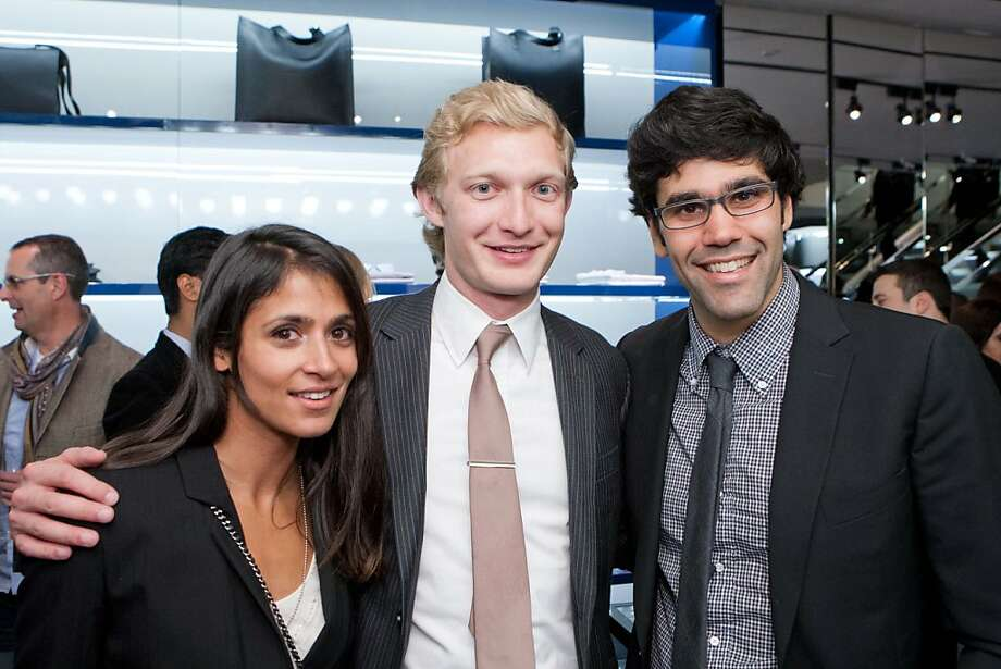 "It was a night for the guys to talk about style. Sonia McFarland, (left) Luther Lowe, director of government affairs for Yelp, and Michael Stoppelman, VP of engineering at Yelp, dressed in their cocktail party best. Lowe said his signature look is ""yupster,"" defined as ""Mission District hipster meets Capitol Hill."" ""I like Nike high tops, Ben Sherman skinny jeans, a T-shirt from American Apparel and a navy blazer,"" Lowe said. Stoppelman said he pairs hoodies bought in Hayes Valley with semi-skinny jeans for his ""Marina-hipster chic."" ""I'm  not into brands,"" he said. ""That's what defines a hipster."" Photo: Drew Altizer Photography"