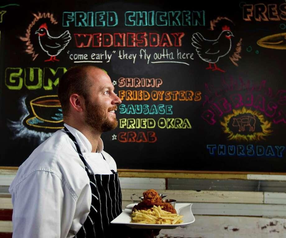 Liberty Kitchen Chef de Cuisine Travis Lenig shows his fried chicken plate, Wednesday, Aug. 22, 2012, in Houston.  ( Nick de la Torre / Houston Chronicle ) Photo: Nick De La Torre, Staff / Houston Chronicle