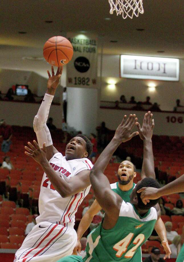 11/9/12: Houston Cougars forward Danuel House (23) shoots over Florida A&M Rattlers forward Onyekachukwu Odi (42) at the Hofheinz Pavilion on November 9, 2012 at the University of Houston in Houston, Texas. At halftime Florida was winning 35 to 34. Photo: Thomas B. Shea, For The Chronicle / © 2012 Thomas B. Shea