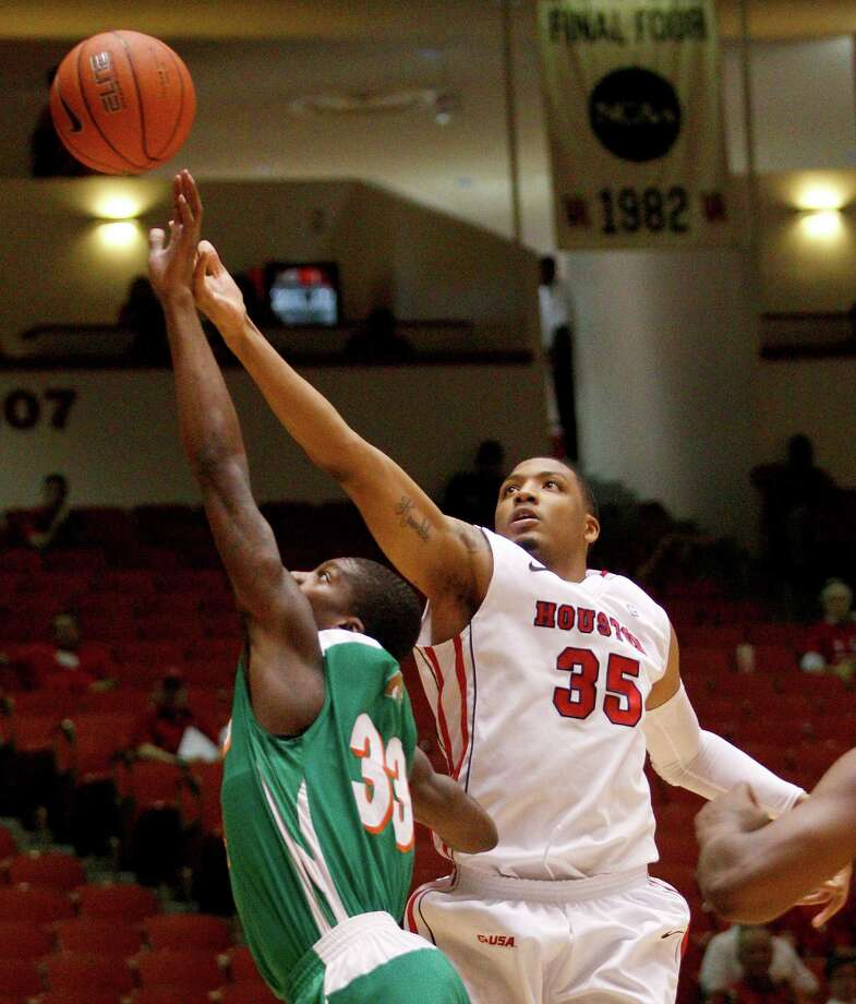 11/9/12: Houston Cougars forward TaShawn Thomas (35) out rebounds Florida A&M Rattlers guard Walter Davis (33) at the Hofheinz Pavilion on November 9, 2012 at the University of Houston in Houston, Texas. At halftime Florida was winning 35 to 34. Photo: Thomas B. Shea, For The Chronicle / © 2012 Thomas B. Shea