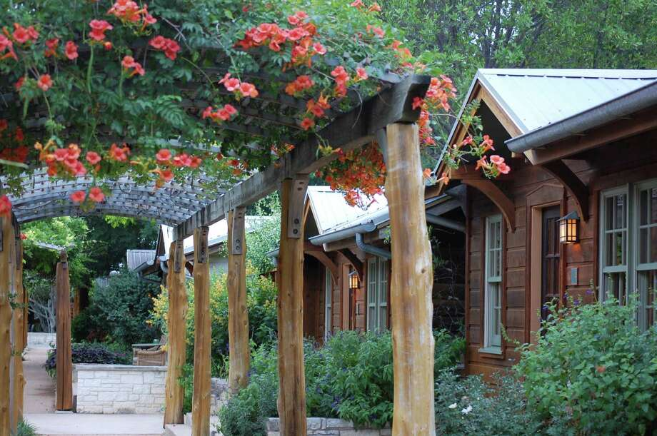 Lake Austin Spa Resort has 40 lakeside rooms and arbors covered in trumpet vine. Photo: Melissa Ward Aguilar