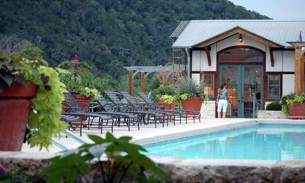 Clockwise from top: Lake Austin Spa Resort has 40 lakeside casitas with arbors covered in trumpet vine. Sculling is a favorite morning workout at the spa. The outdoor pool features a stunning Hill Country backdrop.   Chef Stéphane Beaucamp Photo: Melissa Ward Aguilar