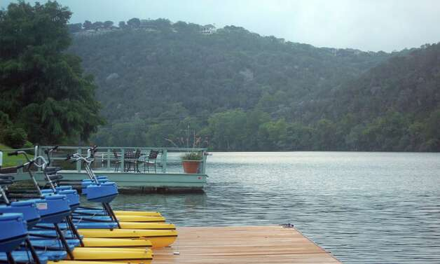 Water bikes, kayaks and stand-up paddleboards are ready for guests at Lake Austin Spa Resort. Photo: Melissa Ward Aguilar