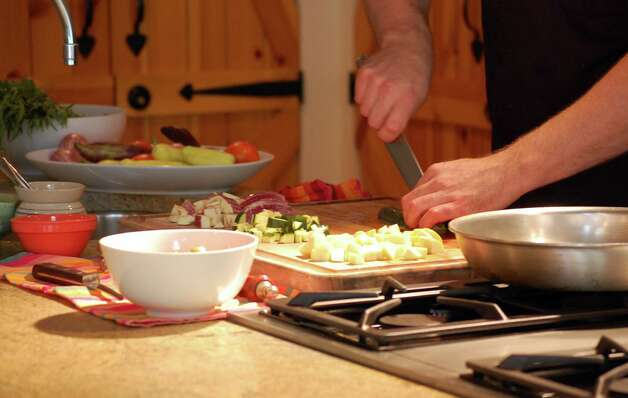 Chef Stéphane Beaucamp chops squash fresh from the garden for an afternoon cooking class. Photo: Melissa Ward Aguilar